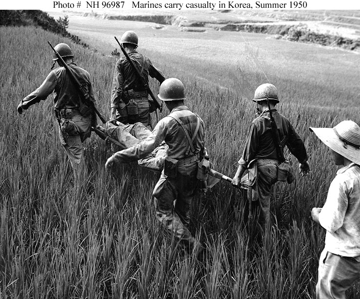 Marines_carrying_wounded_-_Pusan